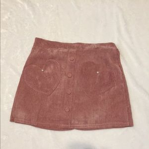 Pink corduroy skirt with heart pockets.